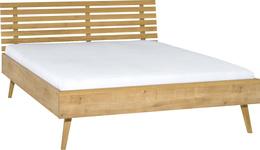 Bed with openwork headboard